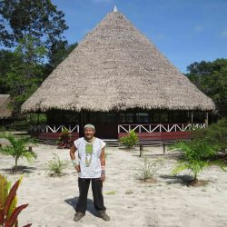 Shaman Ricardo Amaringo in front the maloka of Nihue Rao Centro Espiritual